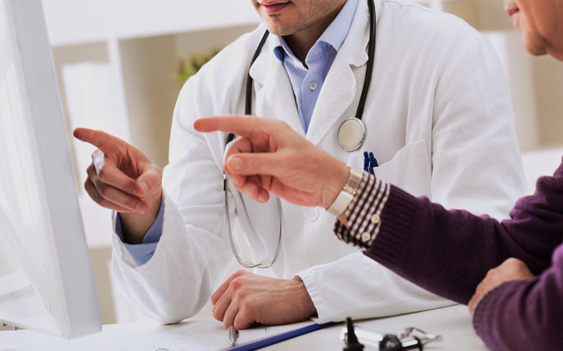 Doctor working on patient