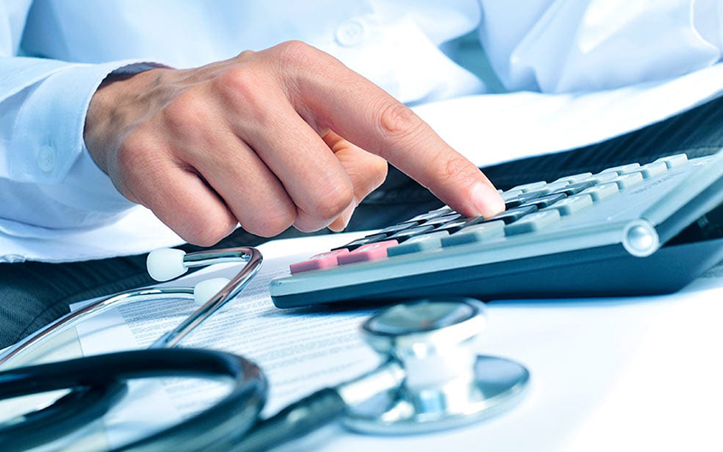 Doctors working on calculator
