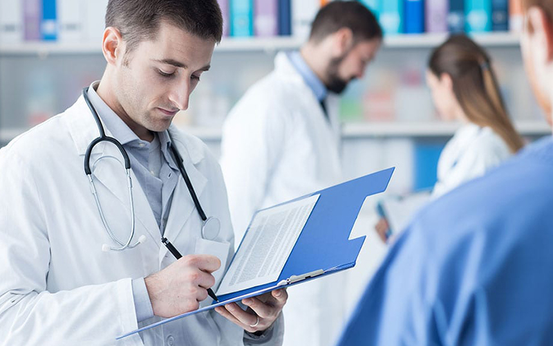 Doctors working with paperwork