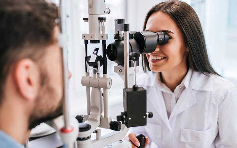 Doctor doing eye exam