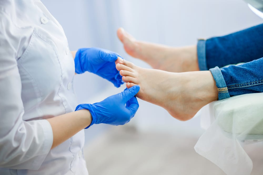 Doctor working with foot