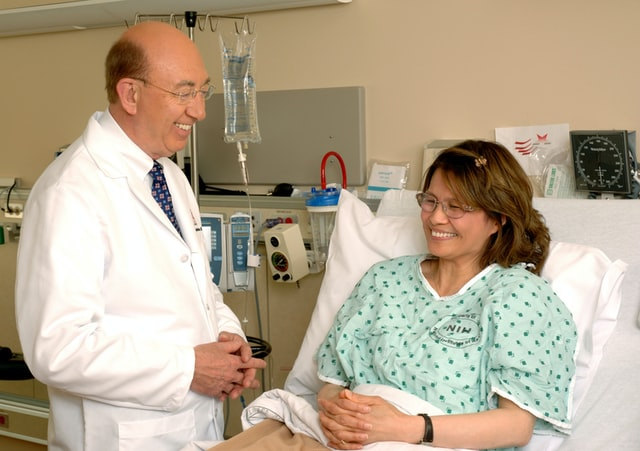 Doctor and patient smiling