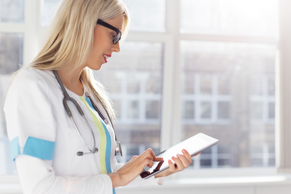 Doctor looking at patient medical records on a tablet computer