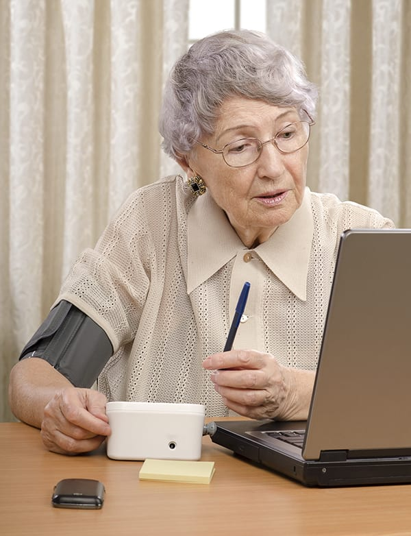 Woman receiving telemedicine services