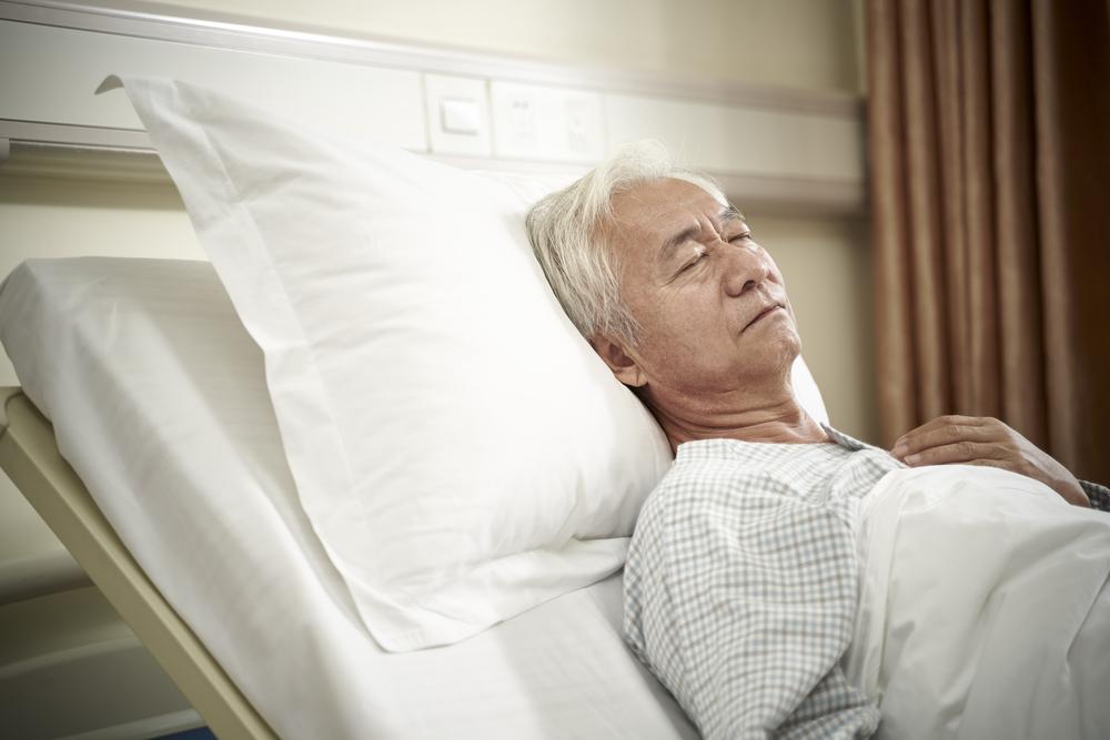 Senior patient sleeping in bed